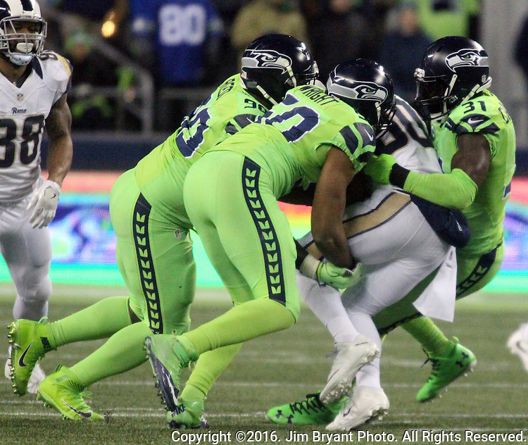 Los Angeles Rams running back Todd Gurley (30) is held to no gain by Seattle Seahawks outside linebacker K.J. Wright (50),  defensive tackle Jarran Reed (90) and strong safety Kam Chancellor (31) during the fourth quarter at CenturyLink Field in Seattle, Washington on December 15, 2016.  The Seahawks beat the Rams 24-3.   ©2016. Jim Bryant Photo. All Rights Reserved