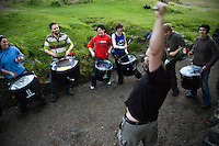 Andy Moore directs a Celtic Beltane drumming practice from St. Anthony's Chapel site near Salisbury Crags in Edinburgh, Scotland, on July 23, 2007.