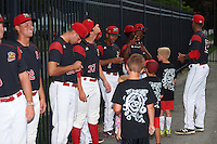 Batavia Muckdogs players, including Pablo Garcia (7) and Samuel Castro, sign autographs for young fans before a game against the West Virginia Black Bears on August 20, 2016 at Dwyer Stadium in Batavia, New York.  Batavia defeated West Virginia 7-2. (Mike Janes/Four Seam Images)
