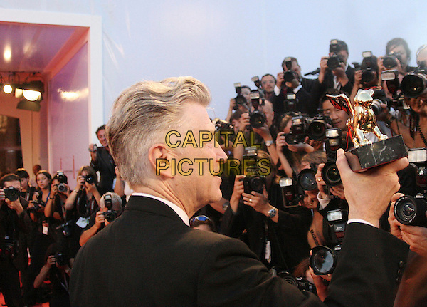 DAVID LYNCH.Receiving a Golden Lion for lifetime achievement award at the 63rd Venice International Film Festival, Italy..September 6th, 2006.Ref: OME/GPA.headshot portrait lion award profile photographers press.www.capitalpictures.com.sales@capitalpictures.com.©Omega/Capital Pictures.