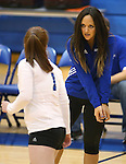 Marymount Assistant Coach Johannah Zabal talks with Cassidie Watson during a college volleyball match against  PSU Harrisburg at Marymount University in Arlington, Vir., on Wednesday, Oct. 9, 2013.<br /> Photo by Cathleen Allison