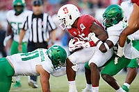 STANFORD, CA - SEPTEMBER 21: Connor Wedington #5 of the Stanford Cardinal is tackled by Verone McKinley III #23 and Isaac Slade-Matautia #41 of the Oregon Ducks during a game between University of Oregon and Stanford Football at Stanford Stadium on September 21, 2019 in Stanford, California.