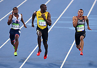 Jamaica's Usain Bolt, looks at Canada's Andre de Grasse as they race the men's 100m semifinals  during the 2016 Olympic Summer Games in Rio de Janeiro, Brazil in Saturday, Aug. 13, 2016. THE CANADIAN PRESS/Sean Kilpatrick