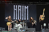 HAIM - L-R: Alana Haim, Dash Hutton, Danielle Haim, Este Haim - performing live on the Pyramid Stage on Day One at the 2013 Glastonbury Festival held at Pilton Farm Pilton Somerset UK - 28 Jun 2013.  Photo credit: George Chin/IconicPix