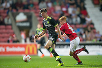 Mason Mount of Chelsea moves away from Tom Smith of Swindon Town during the The Checkatrade Trophy match between Swindon Town and Chelsea U23 at the County Ground, Swindon, England on 13 September 2016. Photo by Andy Rowland.