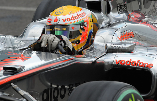 British driver Lewis Hamilton of McLaren Mercedes drives his car across the race track during qualifying at Spa-Francorchamps Circuit near Spa, Belgium