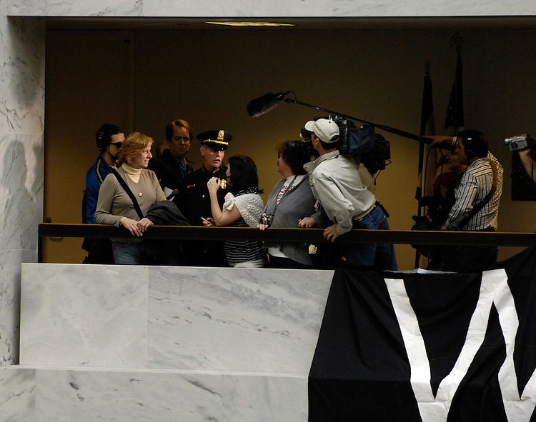Protesters are removed from the 5th floor of the Hart Senate Office Building by U.S. Capitol Hill Police after they hung anti-war banners from the hand rails in the upper floor atrium. Here Cindy Sheehan whose son Casey was killed in Iraq is removed from the building while being filmed by TV crews.