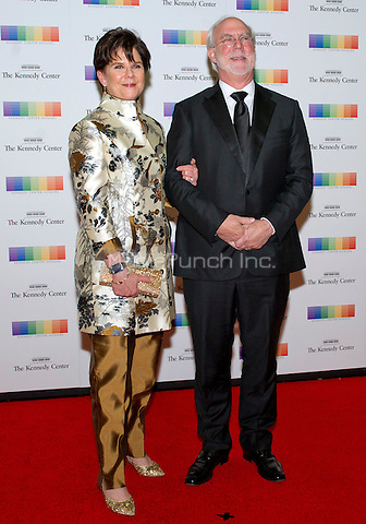 Chairman and Chief Executive Officer of General Dynamics Phebe Novakovic and her husband David Morrison arrive for the formal Artist's Dinner honoring the recipients of the 38th Annual Kennedy Center Honors hosted by United States Secretary of State John F. Kerry at the U.S. Department of State in Washington, D.C. on Saturday, December 5, 2015. The 2015 honorees are: singer-songwriter Carole King, filmmaker George Lucas, actress and singer Rita Moreno, conductor Seiji Ozawa, and actress and Broadway star Cicely Tyson.<br /> Credit: Ron Sachs / Pool via CNP/MediaPunch