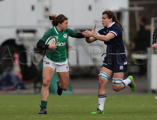 11th March 2018, Donnybrook Stadium, Dublin, Ireland; Womens Six Nations rugby, Ireland Women versus Scotland Women; Katie Fitzhenry (Ireland) hands off a tackle