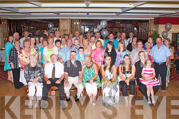 SLIVER ANNIVERSARY: Mary and Martin Leane, Lyrecrompane (seated centre) who celebrated their 25th wedding anniversary with a large group of family and friends at the River Island hotel, Castleisland on Saturday.