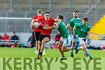 David Clifford on the attack against Ballyduff as he takes the tackle from Paud Costello in the Junior Premier Football Club Championship.