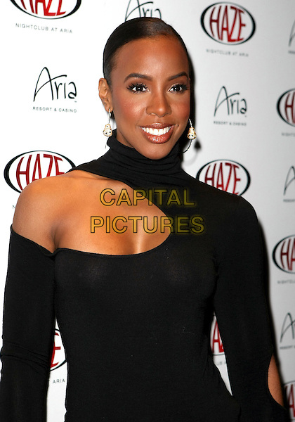 KELLY ROWLAND.A special apperarance by Kelly Rowland at Haze Nightclub inside Aria at CityCenter, Las Vegas, Nevada, USA..February 18th, 2010.half length black top cut out away high collar sleeve earrings cleavage .CAP/ADM/MJT.© MJT/AdMedia/Capital Pictures.