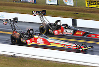Mar 16, 2014; Gainesville, FL, USA; NHRA top fuel driver Doug Kalitta (near) defeats teammate David Grubnic during the Gatornationals at Gainesville Raceway Mandatory Credit: Mark J. Rebilas-USA TODAY Sports