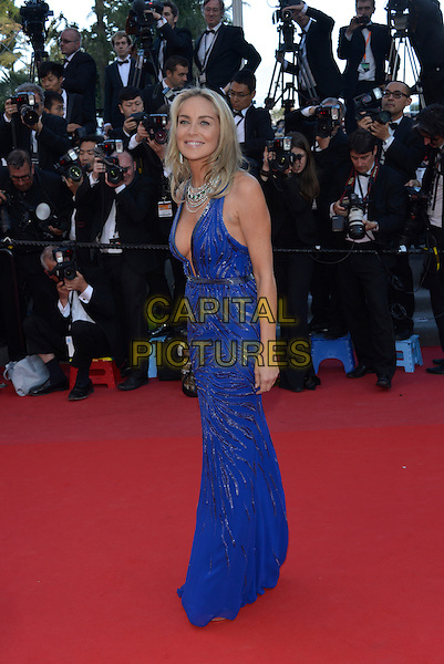 Sharon Stone.'Cleopatra' premiere at the 66th  Cannes Film Festival, France..21st May 2013.full length blue lace dress plunging neckline cleavage  silver necklace side.CAP/PL.©Phil Loftus/Capital Pictures.