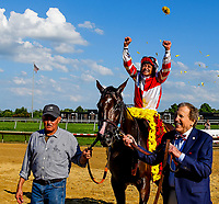 STANTON, DE - JULY 15: Jockey Mike Smith celebrates after guiding Songbird #5 to a win the Delaware Handicap as owner Rick Porter flashes a smile on Delaware Handicap Day on July 8, 2017 at Delaware Park Race Track in Stanton, Delaware. (Photo by Scott Serio/Eclipse Sportswire/Getty Images)