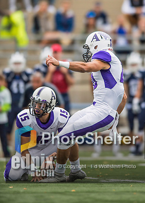 8 October 2016: Amherst College Purple & White Quarterback Craig Carmilani, a Junior from Washington Township, NJ, holds for a field goal by John Rak, a Sophomore from Los Altos, CA, during a game against the Middlebury College Panthers at Alumni Stadium in Middlebury, Vermont. The Panthers edged out the Purple & While 27-26. Mandatory Credit: Ed Wolfstein Photo *** RAW (NEF) Image File Available ***