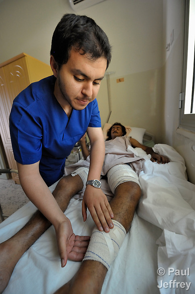 An injured rebel fighter receives care in a Misrata hospital.