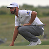 Dustin Johnson reads the greens on the 17th Hole during the first round of the U.S. Open Championship at Shinnecock Hills Golf Club in Southampton on Thursday, June 14, 2018.