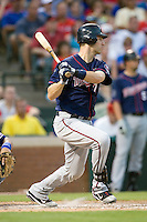 Minnesota Twins catcher Joe Mauer #7 swings during a Major League Baseball game against the Texas Rangers at the Rangers Ballpark in Arlington, Texas on July 27, 2011. Minnesota defeated Texas 7-2.  (Andrew Woolley/Four Seam Images)