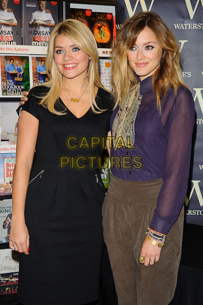 HOLLY WILLOUGHBY & FEARNE COTTON.Sign copies of there new book at Waterstones, Bluewater, Kent, England..October 13th, 2010.half length black dress purple sheer blouse neckerchief beige brown suede trousers grey gray 3/4 bracelets.CAP/CJ.©Chris Joseph/Capital Pictures.