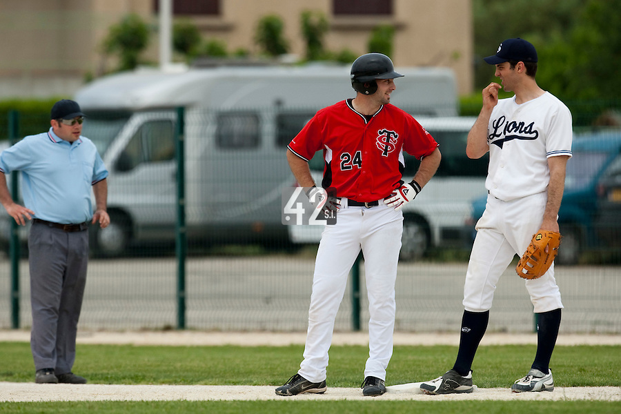 21 May 2009: Gaspard Fessy of Toulouse talks to Sebastien Boyer of Savigny during the 2009 challenge de France, a tournament with the best French baseball teams - all eight elite league clubs - to determine a spot in the European Cup next year, at Montpellier, France.