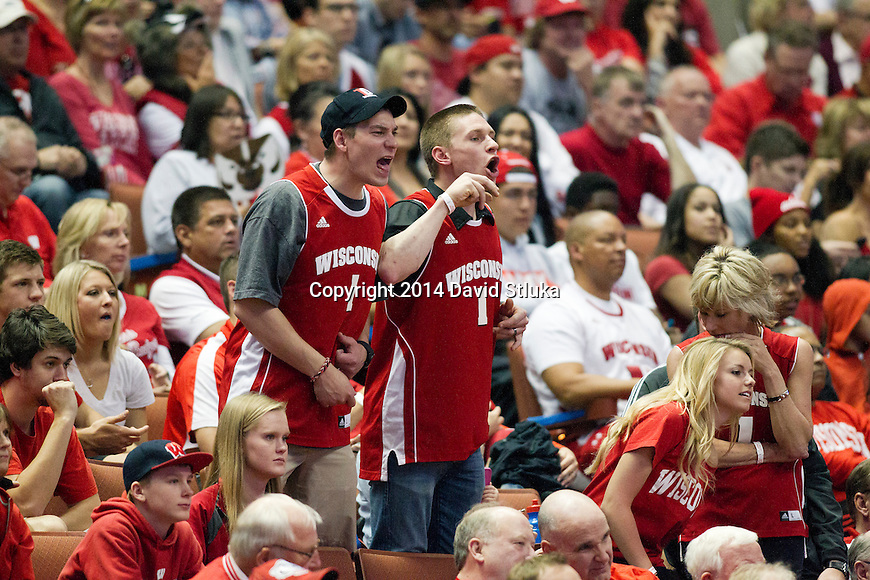 Wisconsin Badgers fans cheer during the fourth-round game in the NCAA college basketball tournament against the Baylor Bears Thursday, March 27, 2014 in Anaheim, California. The Badgers won 69-52. (Photo by David Stluka)