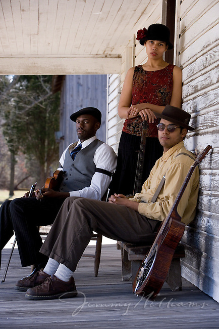 The Carolina Chocolate Drops pose on the porch of a building at Historic Stagville Plantation in Durham, NC.
