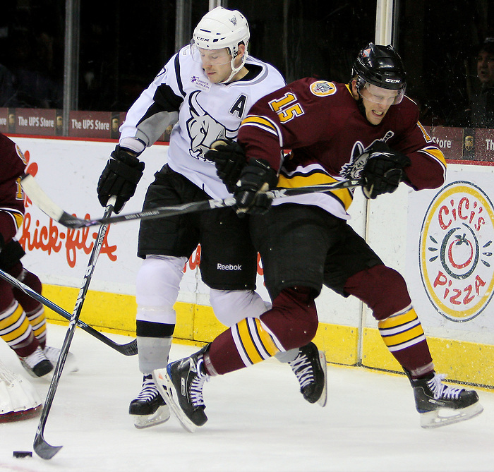 San Antonio's Kevin Porter, left, collides with Chicago's Joey Crabb during the second period of an AHL hockey game between the Chicago Wolves and the San Antonio Rampage, Thursday, Jan. 14, 2010, at the AT&T Center in San Antonio. (Darren Abate/pressphotointl.com)