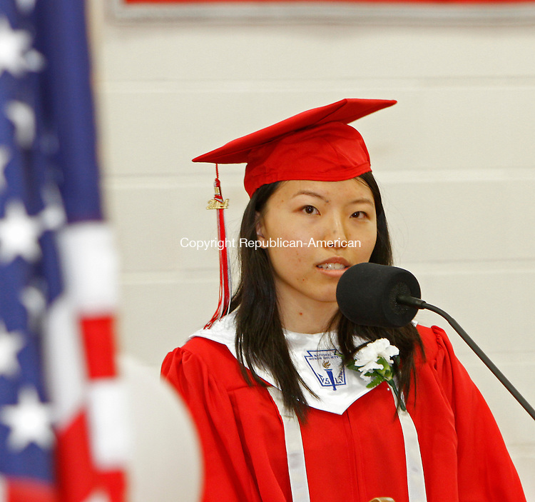 Southbury, CT-17 June 061714MK03 class of 2014 salutatorian Ruijia Yang addresses her classmates during Pomperaug Regional High School's commencement exercises Tuesday evening in Southbury. Michael Kabelka / Republican-American