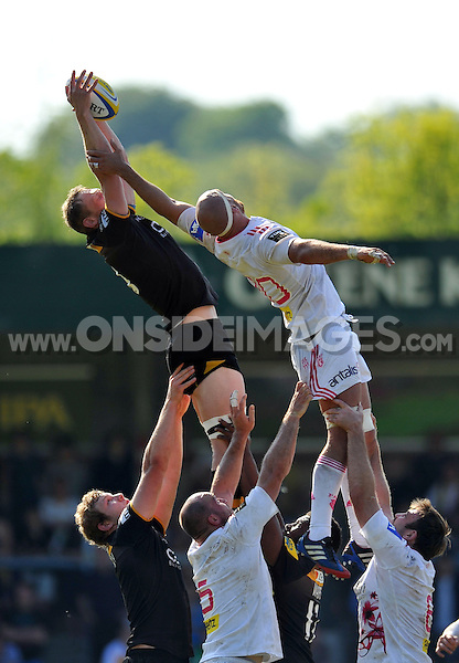 Kearnan Myall rises high to win lineout ball. European Champions Cup play-off, between London Wasps and Stade Francais on May 18, 2014 at Adams Park in High Wycombe, England. Photo by: Patrick Khachfe / JMP