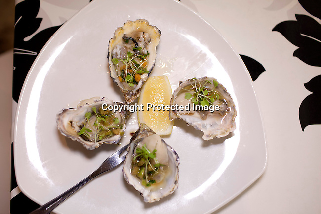 CAPE TOWN, SOUTH AFRICA - MARCH 22: An oyster dish at bizerca bistro on March 22, 2012 in Cape Town, South Africa (Photo by Per-Anders Pettersson)