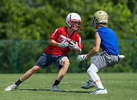 NWA Democrat-Gazette/BEN GOFF @NWABENGOFF<br /> Payton Byerley, Glendale (Mo.) receiver, evades Colton Shaver, Harrison free safety, Thursday, July 11, 2019, during the Border Battle 7-on-7 Tournament, in partnership with the Pro Football Hall of Fame Scholastic 7v7 series, at Branson (Mo.) High School's Pirates Stadium.