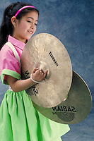 Cymbals played by a young Hispanic girl.  May not be used in an elementary school dictionary. Cleveland Ohio USA.