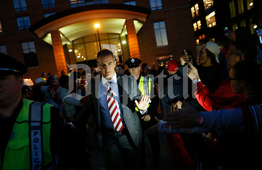 Ohio State Buckeyes head coach Urban Meyer high fives fans as he leads the team to the Skull Session in St. John Arena before the college football game between the Ohio State Buckeyes and the Minnesota Golden Gophers at Ohio Stadium in Columbus, Saturday night, November 7, 2015. (The Columbus Dispatch / Eamon Queeney)