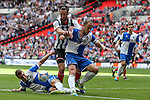 Ollie Palmer of Grimsby Town (centre) tries to find a way past Lee Brown of Bristol Rovers (left) and Mark McChrystal of Bristol Rovers (3rd left) during the 2015 Vanarama Conference Promotion Final match between Grimsby Town and Bristol Rovers at Wembley Stadium, London<br /> Picture by David Horn/eXtreme aperture photography +44 7545 970036<br /> 17/05/2015