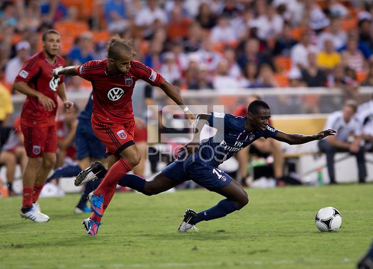 Blaise Matuidi (14) of Paris Saint-Germain FC is fouled by Maicon Santos (29) of D.C. United during the game at RFK Stadium in Washington, DC.  Paris Saint-Germain FC tied D.C. United, 1-1.