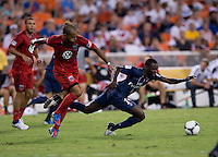 Blaise Matuidi (14) of Paris Saint-Germain FC is fouled by Maicon Santos (29) of D.C. United during the game at RFK Stadium in Washington, DC.  Paris Saint-Germain FC tied D.C. United, 1-1.