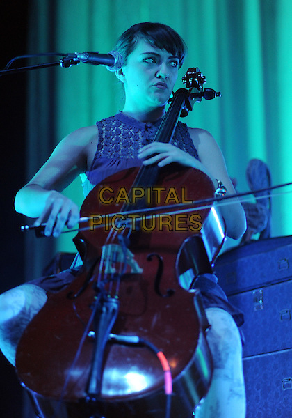 Cello player NEYLA PEKAREK for the American folk rock band THE LUMINEERS performs to a Sold Out concert at a stop on their U.S. tour held at the Stage AE, Pittsburgh, PA., USA..February 5th, 2013.on stage in concert live gig performance performing music half length sitting .CAP/ADM/JN.©Jason L Nelson/AdMedia/Capital Pictures.