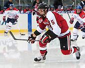 Matt Benning (NU - 5) - The Northeastern University Huskies defeated the University of Massachusetts Lowell River Hawks 4-1 (EN) on Saturday, January 11, 2014, at Fenway Park in Boston, Massachusetts.