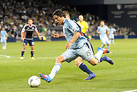 Roger Espinoza (15)  Sporting KC midfielder drives at the New England goal... Sporting Kansas City defeated New England Revolution 3-0 at LIVESTRONG Sporting Park, Kansas City, Kansas.