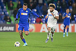 GETAFE, SPAIN - DECEMBER 12: FC Krasnodar's Tonny Vilhena and Getafe CF's  Jason in action during the UEFA Europa League group C match between Getafe CF and FK Krasnodar at Coliseum Alfonso Perez on December 12, 2019 in Getafe, Spain. <br /> (ALTERPHOTOS/David Jar)