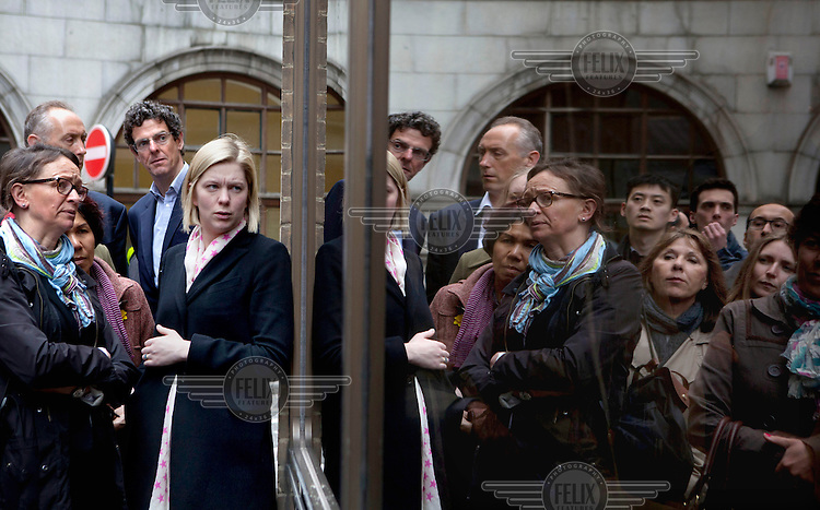 People watch coverage of the funeral of Margret Thatcher on a TV screen in a shop window near St Paul's Cathedral as the coffin arrives on a gun carriage from St Clement Danes. Margaret Thatcher, the former British Prime Minister, died on 8 April 2013 after suffering a stroke. She was accorded the rare accolade of a ceremonial funeral.