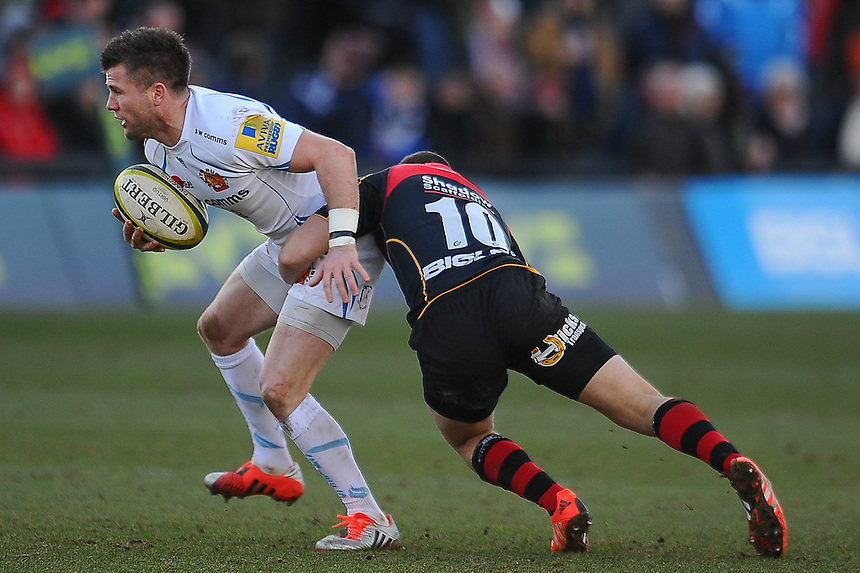 Exeter Chiefs' Ceri Sweeney is tackled by Newport Gwent Dragons' Dorian Jones<br /> <br /> Photographer Craig Thomas/CameraSport<br /> <br /> Rugby Union - European Rugby Challenge Cup Pool 3 - Newport Gwent Dragons v Exeter Chiefs - Sunday 1st February  2015 - Rodney Parade - Newport <br /> <br /> &copy; CameraSport - 43 Linden Ave. Countesthorpe. Leicester. England. LE8 5PG - Tel: +44 (0) 116 277 4147 - admin@camerasport.com - www.camerasport.com