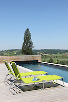 The outdoor swimming pool is surrounded by a deck of chestnut wood and has views over the Lendou Valley