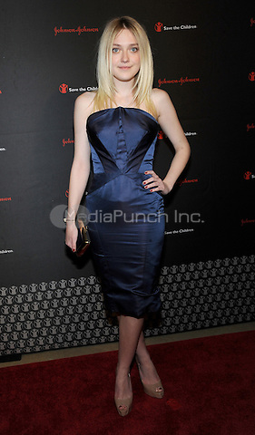 New York, NY-  November 19: Dakota Fanning attends the 2nd Annual Save The Children Illumination Gala presented by Johnson & Johnson on November 19, 2014 at the Plaza Hotel in New York City. Credit: John Palmer/MediaPunch
