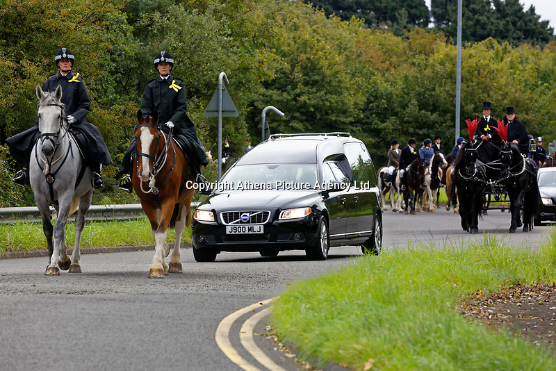 "Pictured: The funeral cortege approaches Margam Crematorium, Wales, UK. Monday 08 October 218<br /> Re: A grieving father will mourners on horseback at the funeral of his ""wonderful"" son who killed himself after being bullied at school.<br /> Talented young horse rider Bradley John, 14, was found hanged in the school toilets by his younger sister Danielle.<br /> Their father, farmer Byron John, 53, asked the local riding community to wear their smart hunting gear at Bradley's funeral.<br /> Police are investigating Bradley's death at the 500-pupils St John Lloyd Roman Catholic school in Llanelli, South Wales.<br /> Bradley's family claim he had been bullied for two years after being diagnosed with Attention Deficit Hyperactivity Disorder.<br /> He went missing during lessons and was found in the toilet cubicle by his sister Danielle, 12."
