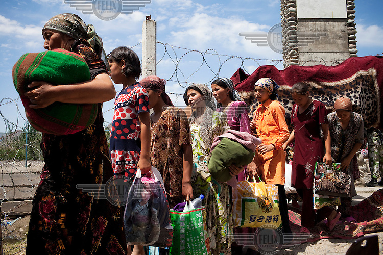Ethnic Uzbek families travel back to their homes in Kyrgyzstan not long after they crossed the border into Uzbekistan. The Uzbek authorities then forced them to leave. Fighting between ethnic Kyrgyz and Uzbeks in southern Kyrgyzstan left hundreds dead and up to 400,000 displaced.