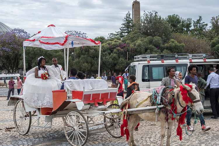 A wedding celebration in the main traffic circle of Axum is followed by a horse-drawn carriage ride for the bride and groom.