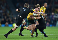 Michael Hooper of Australia takes on the New Zealand defence. Rugby World Cup Final between New Zealand and Australia on October 31, 2015 at Twickenham Stadium in London, England. Photo by: Patrick Khachfe / Onside Images