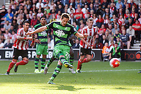 Gylfi Sigurdsson scores a penalty goal to make it 3-1 during the Barclays Premier League match between Southampton v Swansea City played at St Mary's Stadium, Southampton